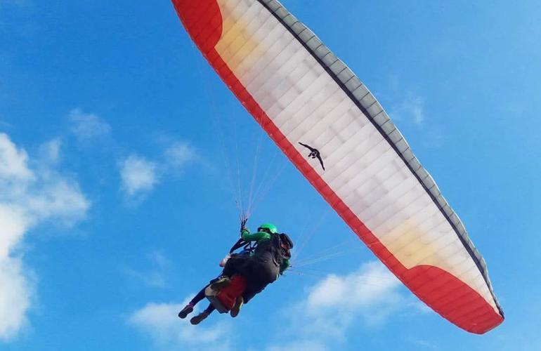 Tandem paragliding flight near Uluwatu, Bali