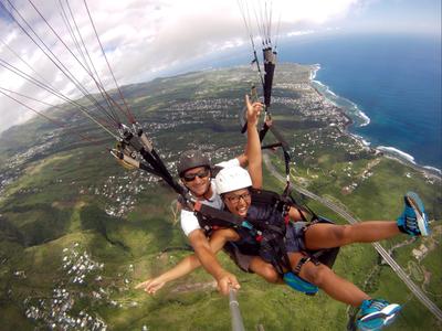 Tandem paragliding flight over the lagoon of Saint Leu, Reunion Island