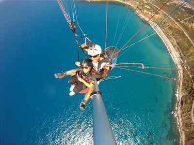 Tandem paragliding flight in Messina, Sicily