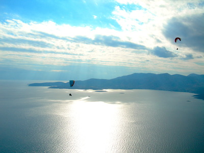 Paragliding: Tandem paragliding flight in the Gulf of Itea at 2000m, Greece