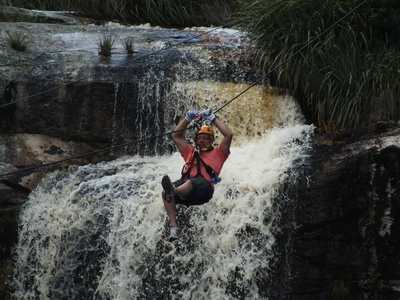 Waterfall zipline tour over the Kruis River