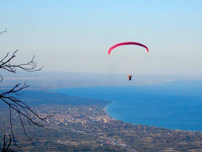 Tandem paragliding flight on wheelchair over Mount Olympus