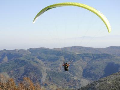 Tandem paragliding flight above the Plastiras lake