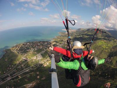 Tandem paragliding flight near Taormina, Sicily