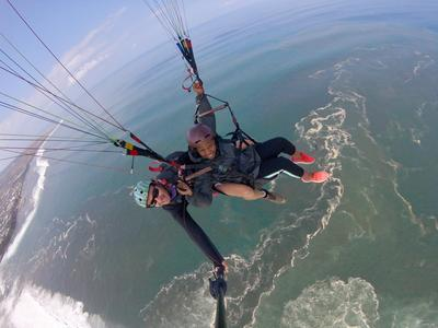 Tandem paragliding flight over the lagoon of Saint Leu, Reunion Island